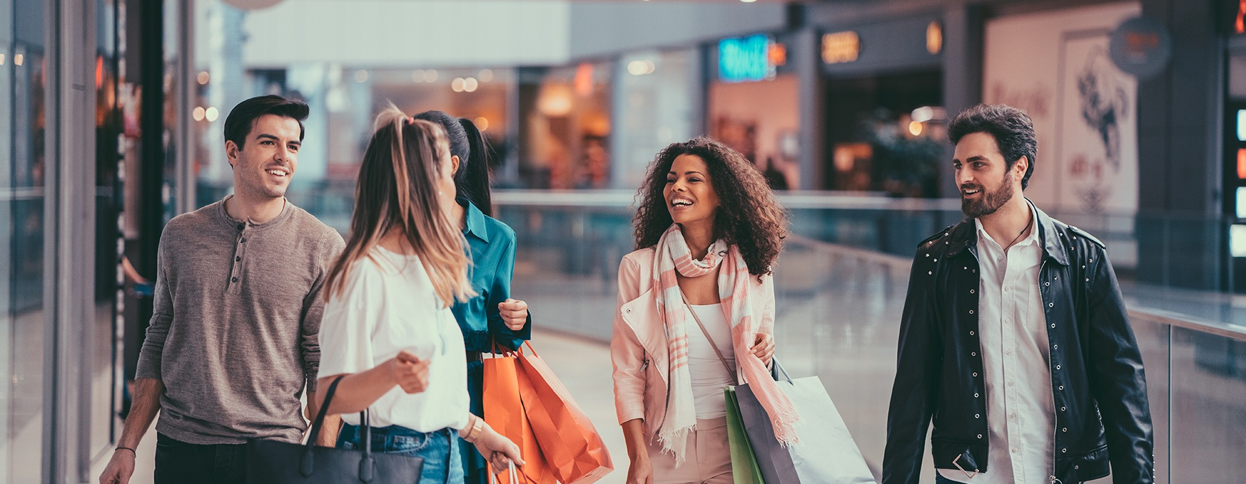 Residents enjoying their time at local shopping centers near The Lofts at Willow Creek