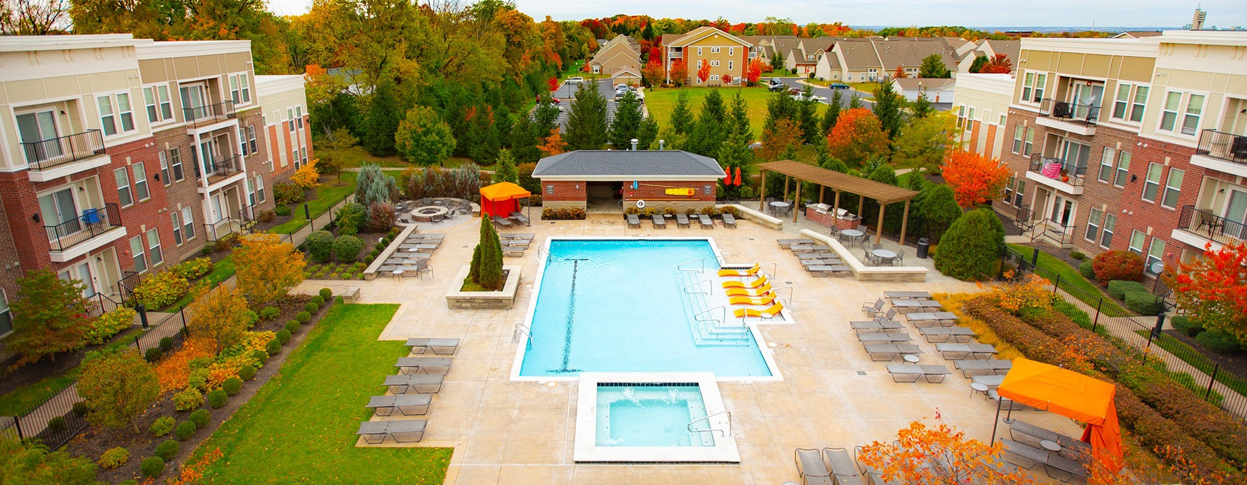 Clear view of the residential pool in between buildings at The lofts at Willow Creek